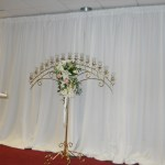 Pipe and drape white on altar