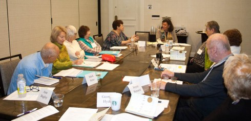 """Sunday morning marked the first appearance of a new TBGBC moderator, Judith Huge (shown here at the head of the table). Judy, an accomplished teacher of writing, is a regular attendee at TBGBC's """"Great Books"""" classes held in conjunction with the Osher Lifelong Learning Institute at USF. Shown in discussion in her group this morning (clockwise from lower left): Marc Simo, Joyce Carpenter, Brenda Tipps, Diane White, Cheryl Walker, moderator Judy Huge, Amanda Putnam, Margaret Hoffman, Ladi Volicer, and Joyce Simard."""
