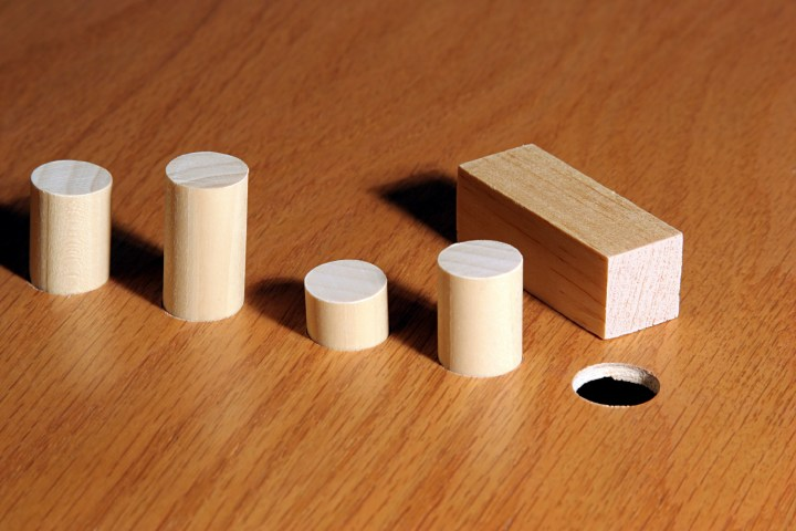 Square peg and a round hole.  Metaphor for a misfit or nonconformist.