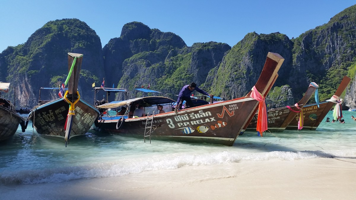 Longtail boats in the green waters of Maya Bay