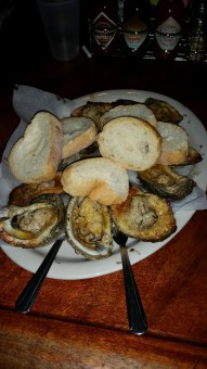 Charbroiled oysters at Acme