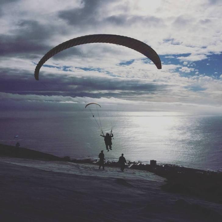 tandem paragliding flight shot
