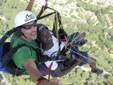Tandem paragliding selfie with a happy client and pilot