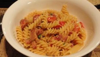 Pasta with Bacon, Chorizo, Tomatoes, Cream And Parmesan