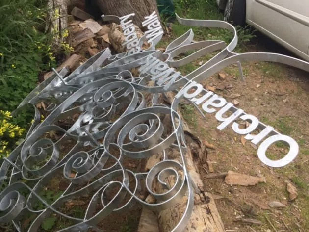 Curlicues and lettering made of metal in a pile
