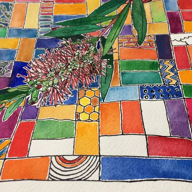 Close up of colourful painting of bottlebrush with a quilt background.