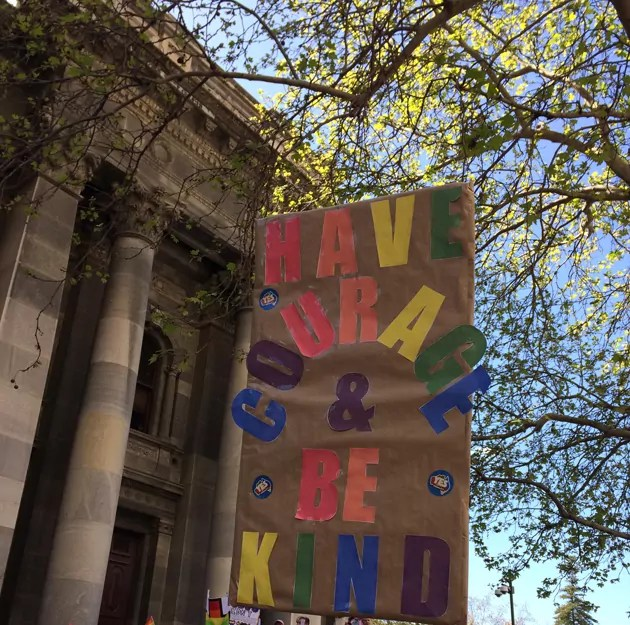 "sign outside Parliament House: ""Have Courage and Be Kind"""