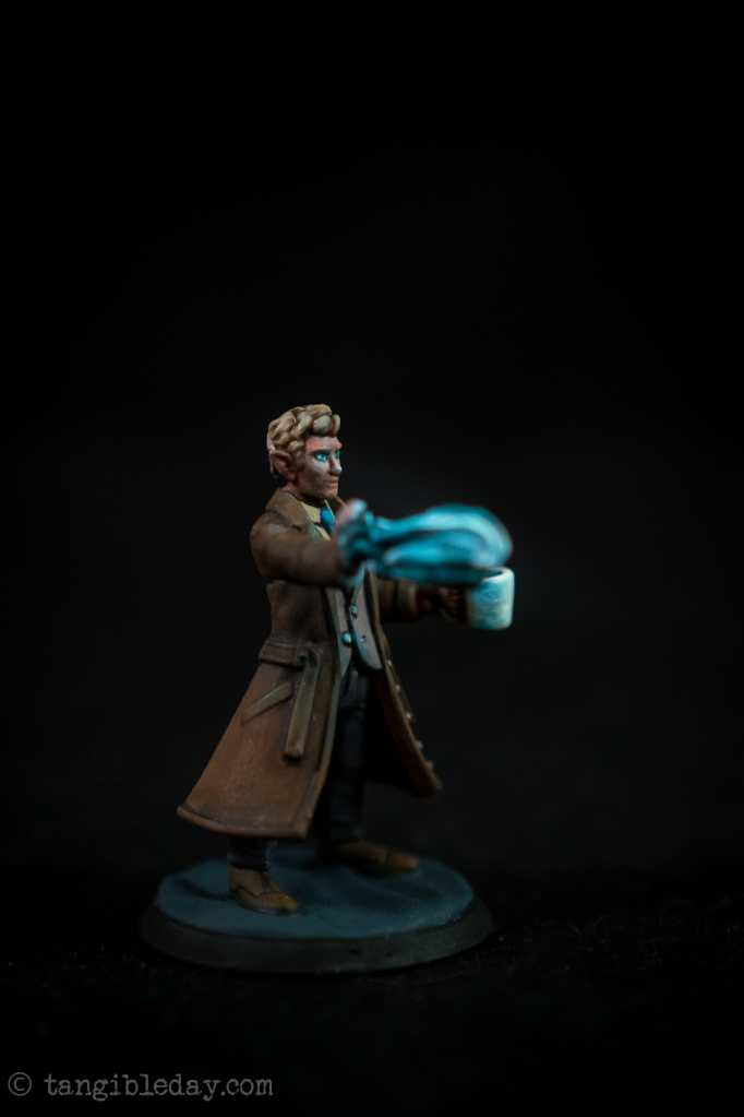 Studio photograph of the painted 3d printed heroforge miniature - using a photo light box booth - side view showing the OSl effect of the fireball