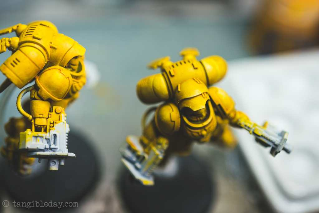 How to Paint Yellow Space Marines (Easy and Fast) - how to paint yellow models and miniatures - dry brushing brighter values makes the miniature pop off the tabletop close up view top