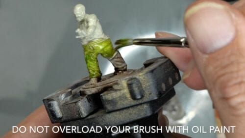 Painting a zombie RPG miniature with oil paints - painting RPG miniatures - oil painting miniatures - origin miniatures - how to paint rpg miniatures - how to paint dungeon and dragons miniatures - painting miniatures and models for role playing games - oil painting 28mm miniatures - do not overload brush