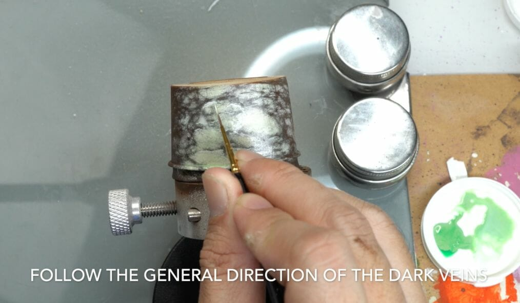 How to paint marble effects on miniatures – painting white marble – painting stone effect miniatures -how to paint marble on miniatures and models – airbrush stencil marble – marbleizing miniatures – airbrushing marble effect - follow the direction of the veins