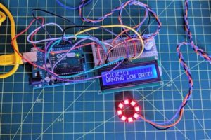A photograph of a collection of circuits on a gird. A digital sign attached to one circuit reads warning low batt!