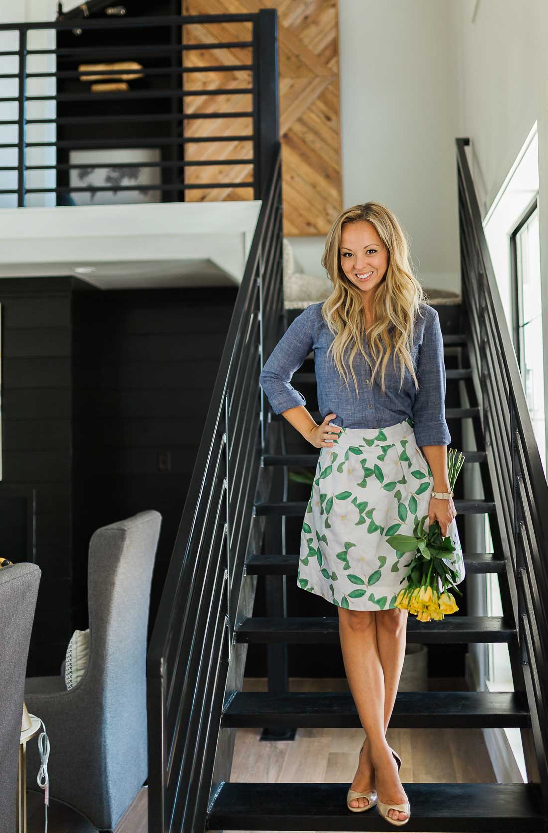 Flirting with Flavor wearing a Skye LeFevre skirt in a Brandon Whatley Home's living area.