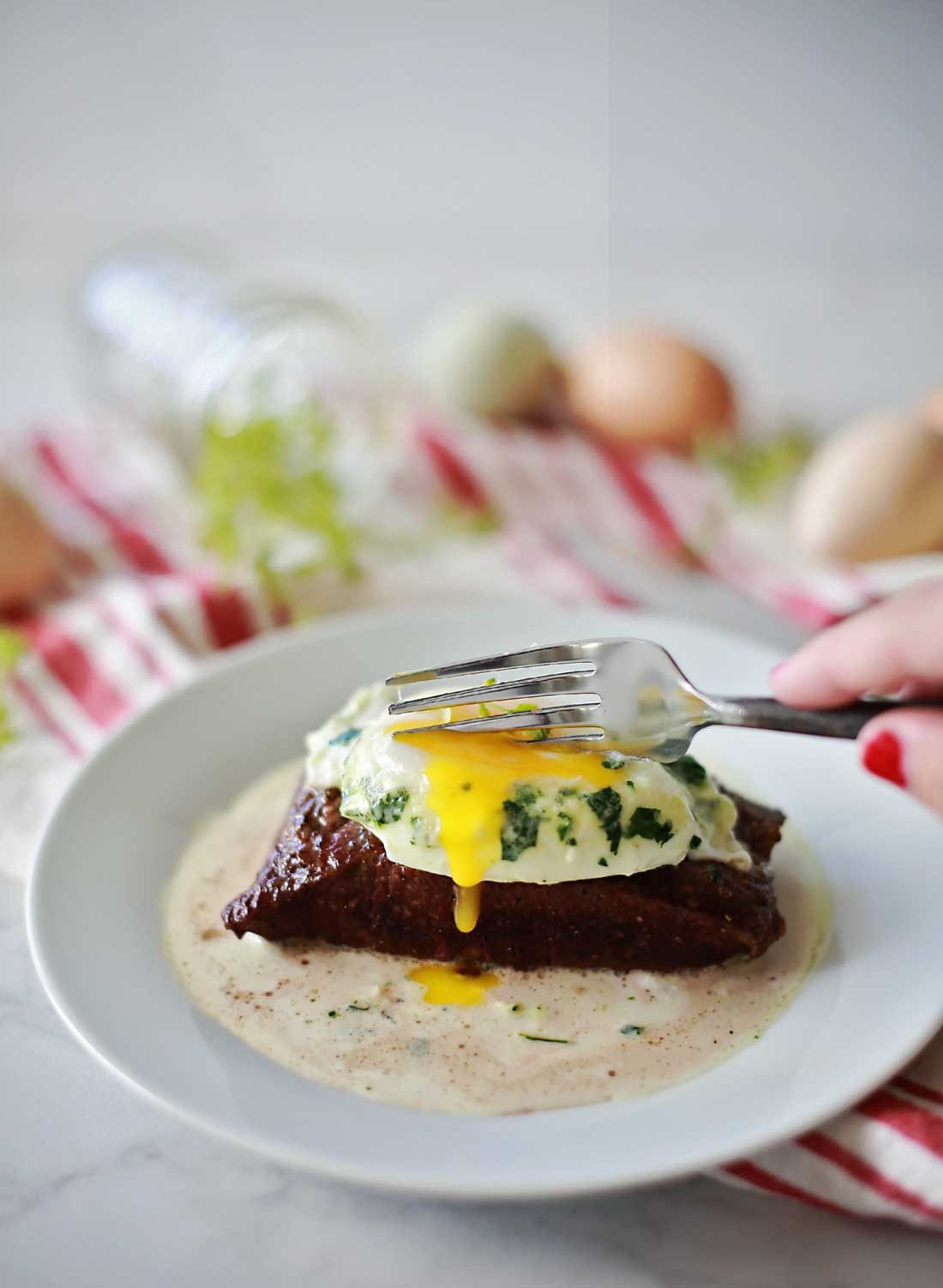 Steak and eggs with herbs and cream. Perfectly cooked flat iron steaks topped with wonderfully cooked eggs and a thick cream of herbs.
