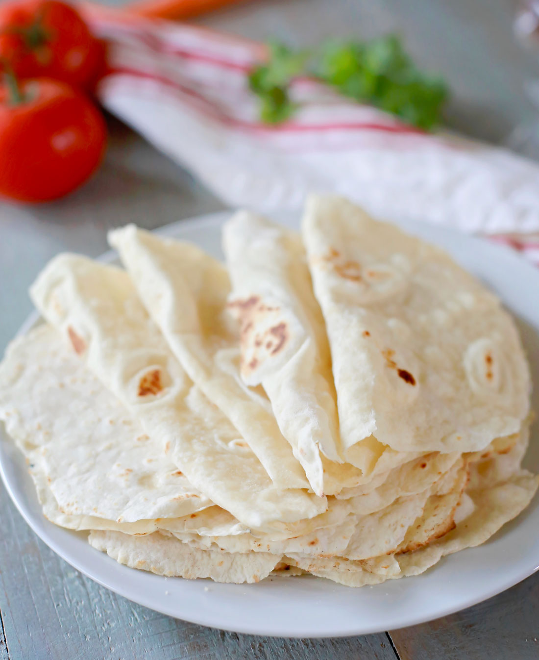 Easy homemade flour tortillas using oil in place of lard for a healthier, yet still soft and delicious flour tortilla from scratch.