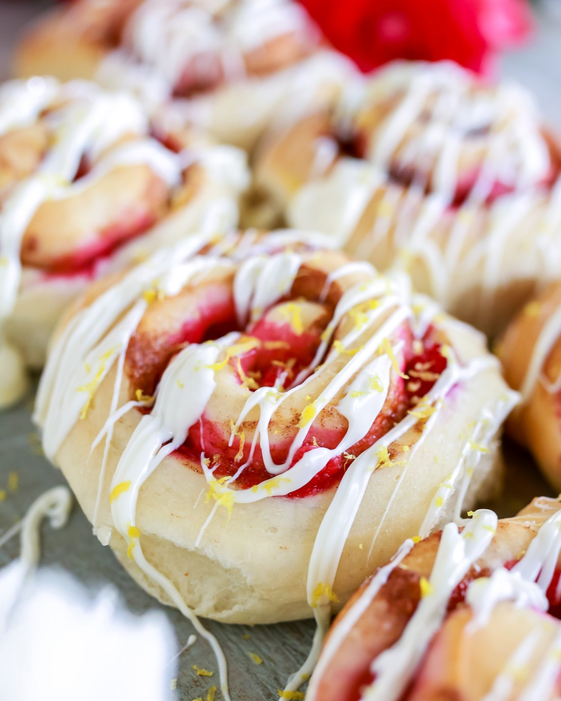 Easy recipe for the most delicious raspberry lemon rolls with a white chocolate drizzle!