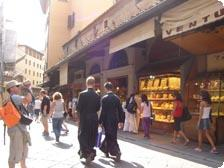 Monks passing jewelry shops on the Pont