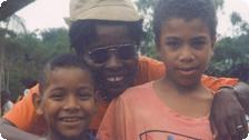 Smiling with village children, Trinidad