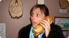 Teresa talking on a penis phone