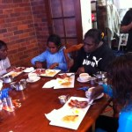 Wadeye runners enjoying breakfast
