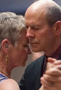 Close-up of David and Jennifer in Argentine tango embrace, dancing a Milonga Las Estrella in Phoenix in March 2014.