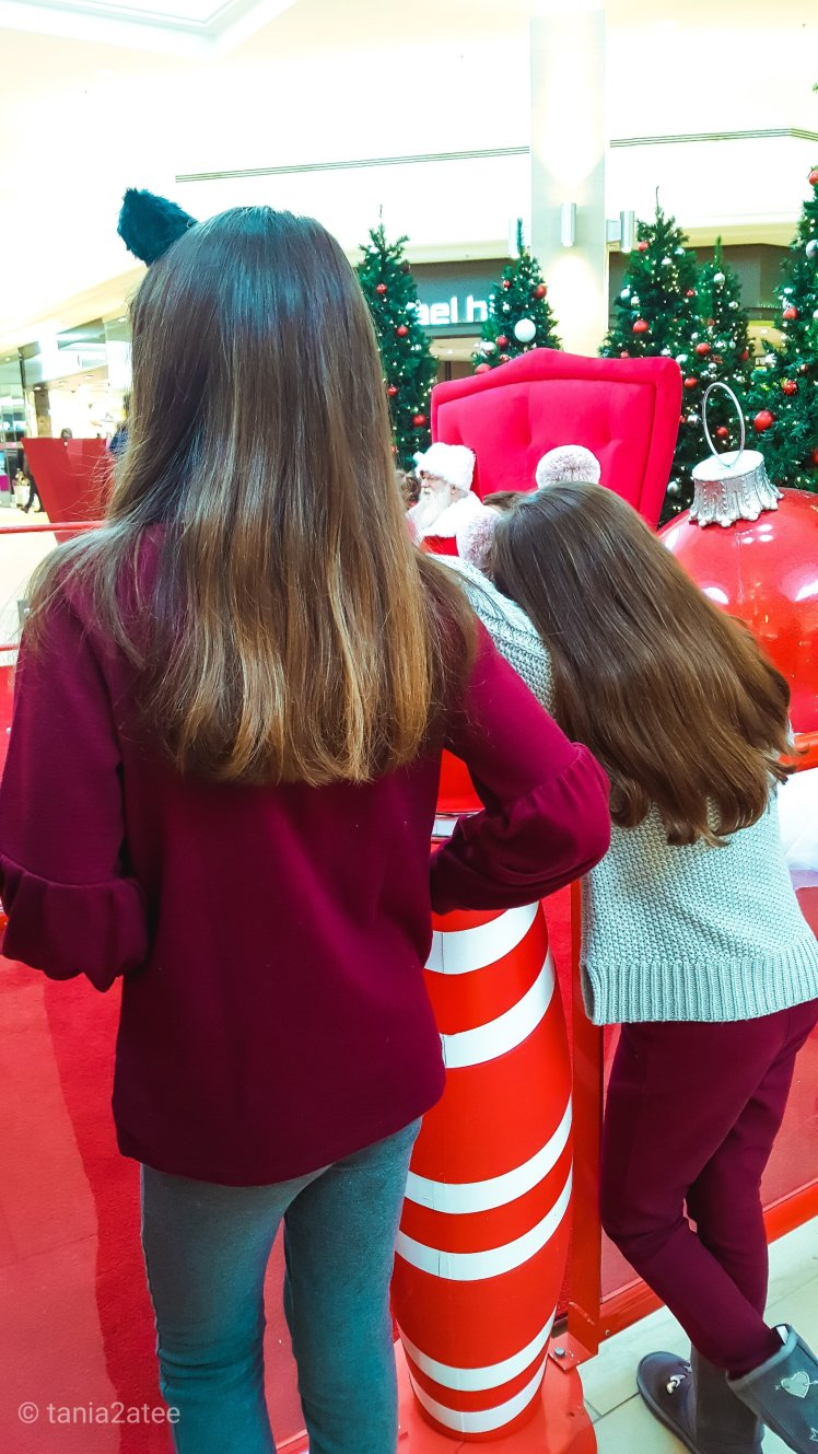 Sisters waiting to see Santa: tania2atee