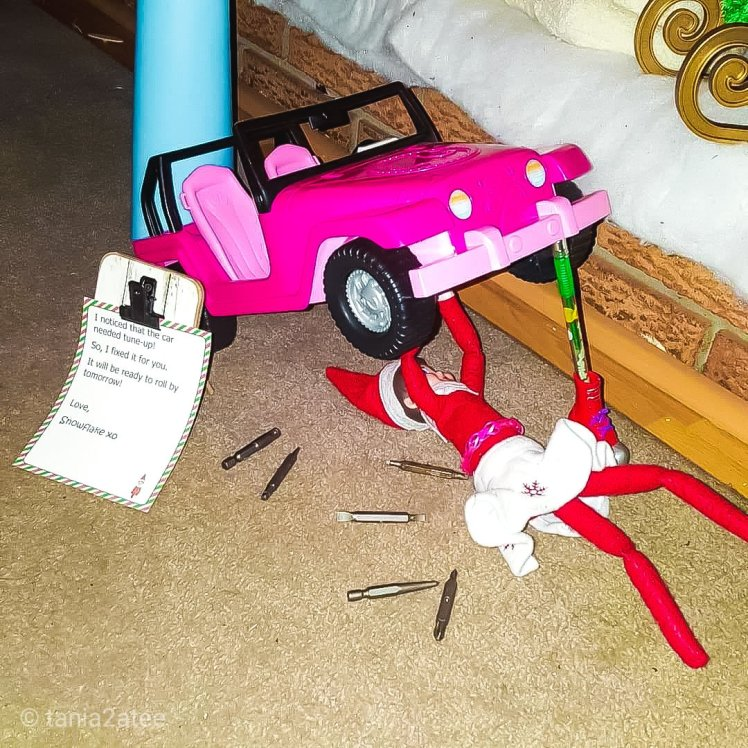 Snowflake the Elf on the Shelf fixing her Barbie car: tania2atee