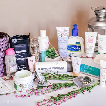 Image of variety of face cleansers and vases