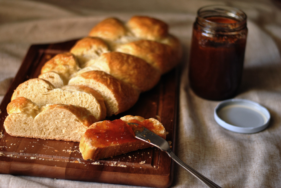 Sliced Zopf bread with jam
