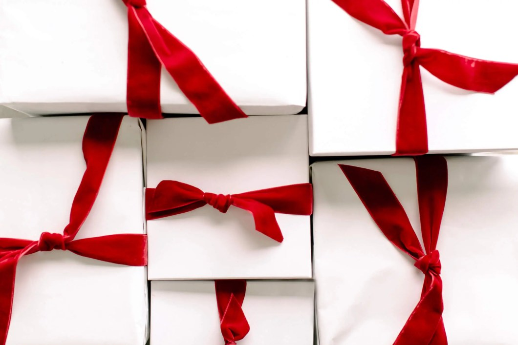 White Christmas gifts with red velvet ribons