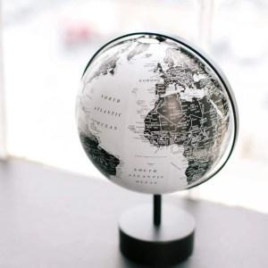 Black and white photo of a world globe