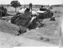 PUCKAPUNYAL, AUSTRALIA. 1943-03-01. TWO ALL-AUSTRALIAN MADE CRUISER TANKS (ACI) UNDERGOING TESTS AND TRIALS.