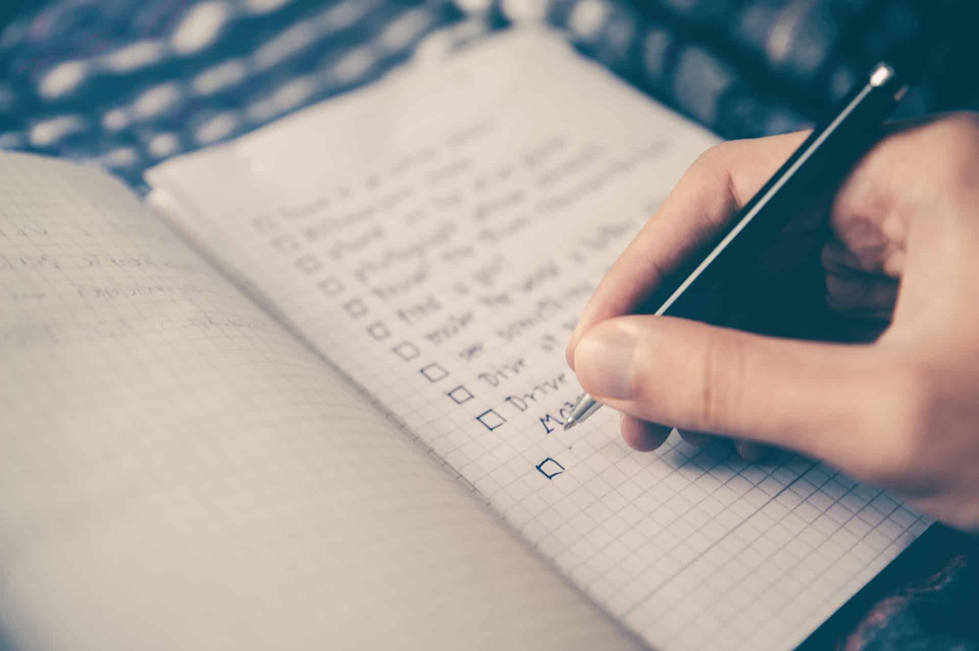 written checklist in notebook
