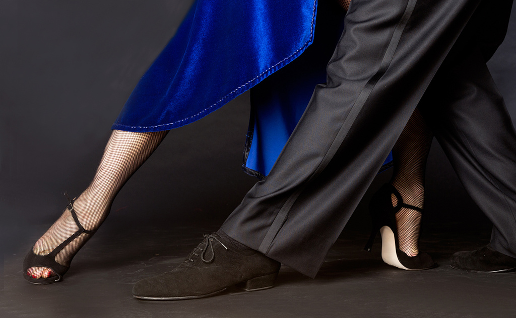 Close-up of feet of couple dancing the tango