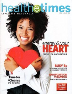 Magazine cover with happy woman holding heart box