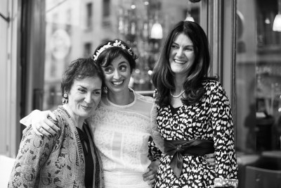Black and white bride with her two sisters