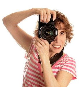 Woman holding camera to her eye