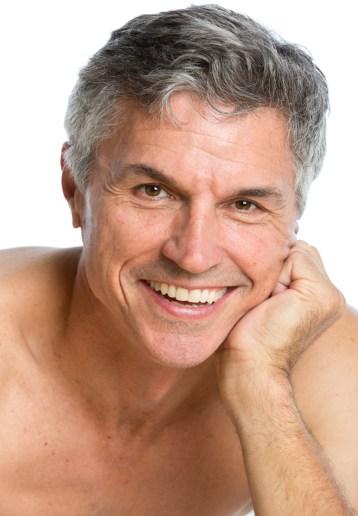 Headshot of happy grey haired man smiling