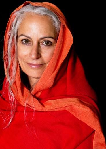Headshot of woman wearing orange scarf