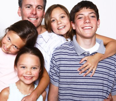 Portrait of family of five smiling