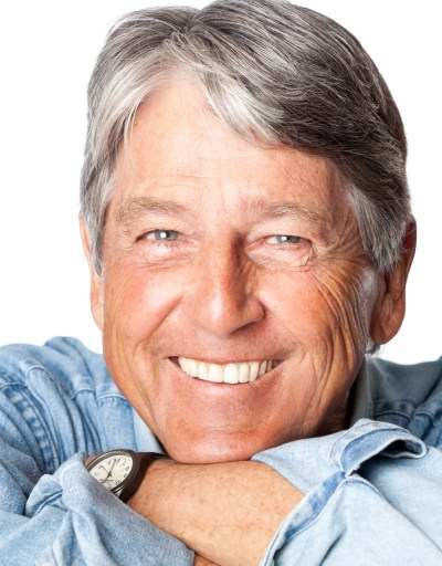 Headshot of man with grey hair smiling