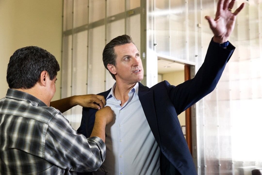 Gavin Newsom being mic'ed for the video