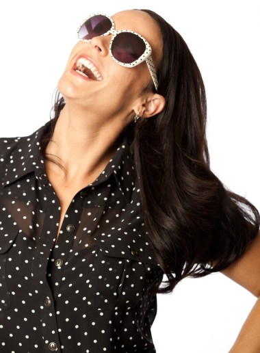 3/4 shot of laughing woman with dark glasses