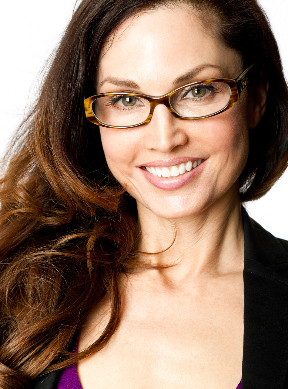 Close headshot of woman with glasses & long hair