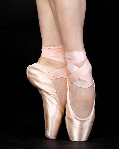 Female ballet dancer's feet on pointe in first position