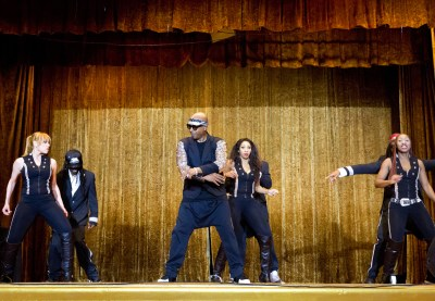 MC Hammer dancing with his dancers at fundraiser