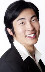 Headshot of handsome Asian man smiling