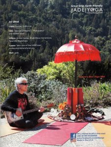 Ad for Jade Yoga mats with man playing his instrument