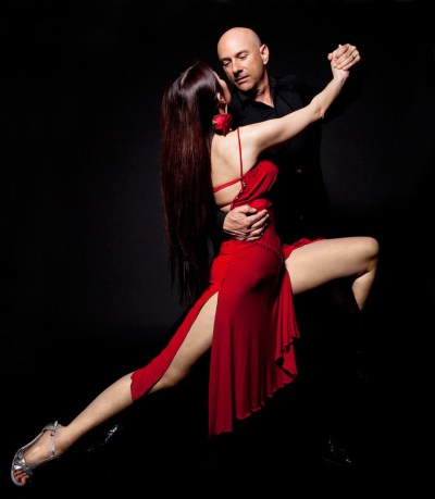 Couple doing tango on black