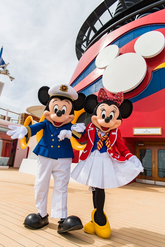 Top 10 Reasons to Book a Disney Cruise to Alaska featured by top US travel blogger, Tanya Foster: image of Captain Mickey and First Mate Minnie on the Disney Wonder
